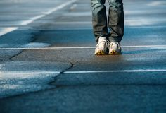 Human legs on pavement Royalty Free Stock Images