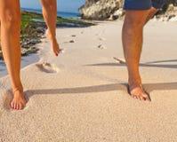 Human legs running on the sand Stock Photos