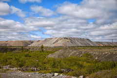 Human-made hills out of soil from an open mine. Human-made hills out of soil, stones and rocks from an open mine Royalty Free Stock Image