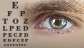 Human male eye closeup, human eye test, alphabet chart royalty free stock photos