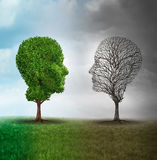 Human mood and emotion. Disorder concept as a tree shaped as two human faces with one half full of leaves and the opposite side empty branches as a medical royalty free illustration