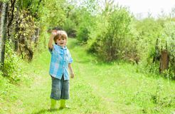 Human and nature. earth day. Eco life. summer activity. small kid gardener walking in forest. farming and agriculture. Copy space. happy child farmer in rubber royalty free stock image