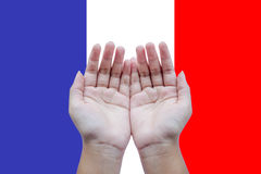 Human open empty hands to pray for France Stock Images