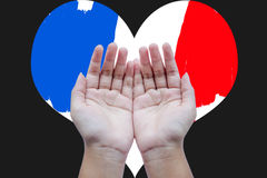 Human open empty hands to pray for France. On heart shaped France flag background Royalty Free Stock Photography