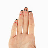 Human palm with funny faces. Painted on fingertips Royalty Free Stock Image