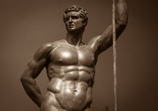 Human perfect body  Ancient male statue.  Royalty Free Stock Images