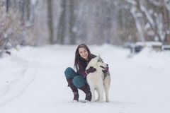Human and Pet Relationships Concepts. Portrait of Lovely Caucasian Brunette Woman Along With Her Husky Dog Royalty Free Stock Photos