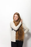 Human pose expressions and emotions. Portrait of young adorable redhead woman showing her gorgeous extra long natural red hair in Royalty Free Stock Image