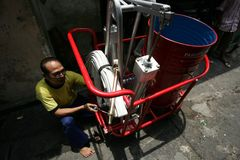 Human-powered fire extinguisher Stock Photo