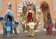 Human Puppets Performing at a Street Festival, Italy Royalty Free Stock Image