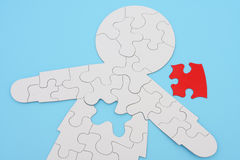 Human Puzzle. Human body shape puzzle with piece removed Stock Images