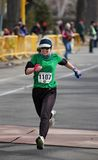 Human Race 5K Woman Crosses Finish Line Stock Image