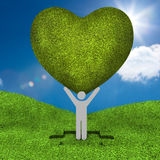 Human representation holding a big green heart Stock Photos