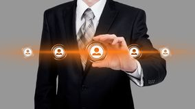Human resource business concept. Businessman presses hr icon on virtual screen.  royalty free stock photo