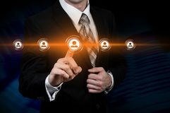 Human resource business concept. Businessman presses hr icon on virtual screen.  stock images