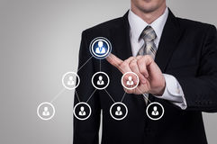 Human resource business concept. Businessman presses hr icon on virtual screen.  stock image