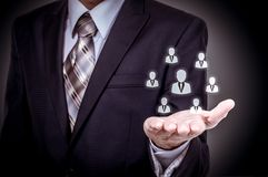 Human resource business concept. Businessman presses hr icon on virtual screen.  royalty free stock photos