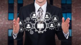 Human resource business concept. Businessman presses hr icon on virtual screen.  stock photo