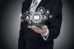 Human resource business concept. Businessman presses hr icon on virtual screen.  stock photos