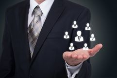 Human resource business concept. Businessman presses hr icon on virtual screen.  stock photography