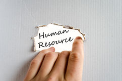 Human resource concept. Hand and text on the cardboard background Human resource Stock Image