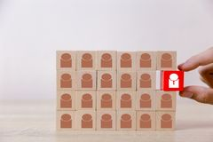 Business man stacking wooden team blocks at table for team management concept or human resource planning stock images