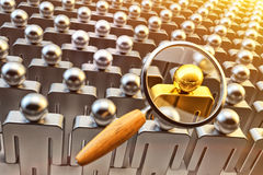 Human resource management, recruitment and hiring concept. Magnifying glass above the crowd of people and chosen one gold person royalty free stock photo