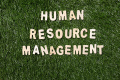 Human Resource Management Wooden Sign On Grass Royalty Free Stock Images