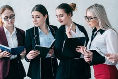 Human resource team business advanced training. Human resources team. Corporate advanced training. Female business colleagues standing with day planners stock images