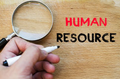 Human resource text concept. Human hand over wooden background and human resource text concept Royalty Free Stock Images