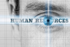 Human Resources. Concept with a closeup greyscale image of a mans eye with selective blue coloring to the iris and the words -  - on radiating light across the Royalty Free Stock Photos