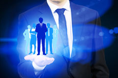 Human resources concept with man's hand. Holding businesspeople silhouettes Royalty Free Stock Photography