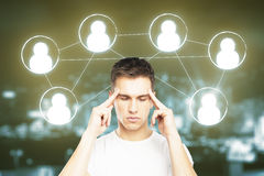 Human resources concept. Thoughtful young man with HR icons on blurry night city background. Human resources concept Stock Photo