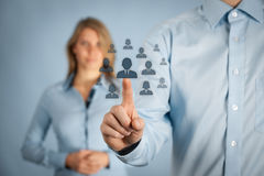 Human resources and CRM. Concept - officer and supervisor looking for employee represented by icon Stock Photography