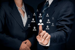 Human resources and CRM. Concept - officer and supervisor looking for employee represented by icon Stock Image