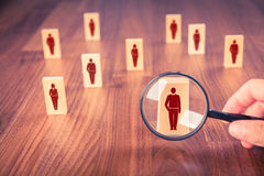 Human resources and CRM. Human resources, CRM, market segmentation and social media concept - officer looking for employee represented by icon Stock Photo