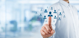 Human resources and CRM. Human resources officer choose employee standing out of the crowd. Select team leader or assessment center concept. Wide composition Stock Image