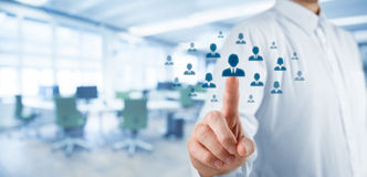 Human resources and CRM. Human resources officer choose employee standing out of the crowd. Select team leader or assessment center concept. Wide composition Stock Images