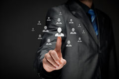 Human resources and CRM. Human resources officer (HR) choose employee standing out of the crowd. Select team leader concept Royalty Free Stock Photography