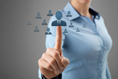 Human resources and CRM. Human resources, CRM and social networking concept - female officer choose person (employee, successor) represented by icon stock photos