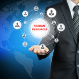 HUMAN RESOURCES (HR) sign on businessman hand Stock Photography