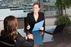 Human resources job talk. Evaluation of a job candidate in a panorama office Stock Photo