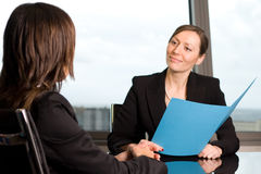 Human resources job talk. Evaluation of a job candidate in a panorama office Stock Images