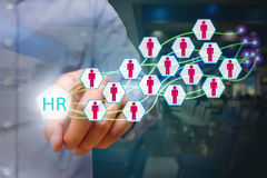Human resources management concept, business man pressing HR icon on virtual screen. royalty free stock photos