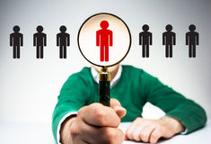 Human resources management. HR manager with magnifier choosing the right employee from variety of condidates. Human resources management and recruitment concept Stock Images