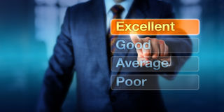 Human Resources Manager Choosing Excellent. Human Resources manager is choosing Excellent atop four buttons, followed by Good, Average and Poor. Business Stock Photo
