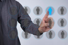 Human resources officer choose employee standing out of the crow. D. Leadership concept stock photos