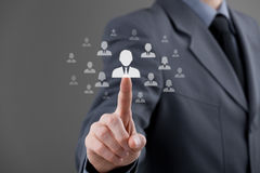 Human resources and CRM. Human resources officer choose employee standing out of the crowd. Select team leader, successor, or assessment center concept. Gender Stock Images