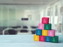 Human resourses and recruitment concept. Wooden blocks pyramid on wooden table Stock Photo