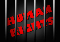 Human rights. Red text Human rights behind jail bars Royalty Free Stock Photography